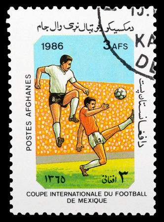 AFGANISTAN - CIRCA 1986: a stamp printed by Afganistan shows football players. World football cup in Maxico, series, circa 1986 photo