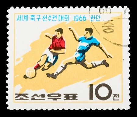 KOREA - CIRCA 1966: A stamp printed in Korea Nord shows football boots, ball and cup with the inscription and name of a series Football World Cup, England, 1966, circa 1966 新聞圖片