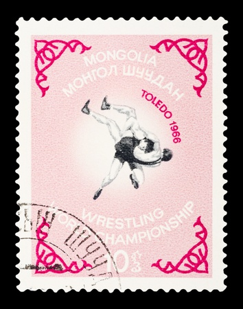postmail: MONGOLIA - CIRCA 1966 : A post stamp printed in Mongolia shows Wrestling World Championship in Toledo, circa 1966 Stock Photo