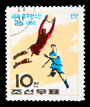 KOREA - CIRCA 1966: A stamp printed in Korea Nord shows football boots, ball and cup with the inscription and name of a series &quot,Football World Cup, England, 1966, circa 1966