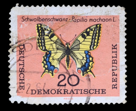 FEDERAL REPUBLIC OF GERMANY - CIRCA 1960s: A stamp printed in the Federal Republic of Germany shows Schwalbenschwanz-Papilio machaon L., circa 1960s photo