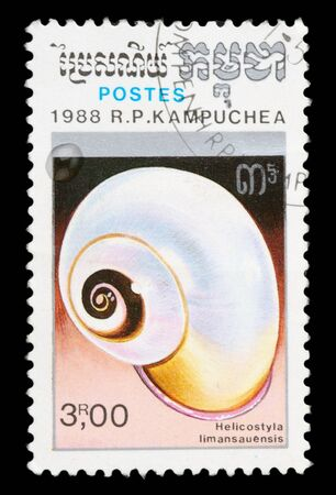 collectible: KAMPUCHEA - CIRCA 1988: A stamp printed in Kampuchea shows shell of Helicostyla limansauensis, circa 1988