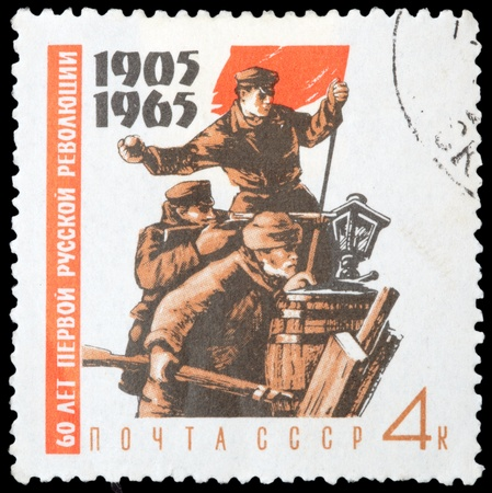 USSR - CIRCA 1965: stamp printed by USSR, shows Fighters on barricades with red flag, circa 1965 Stock Photo - 11797225
