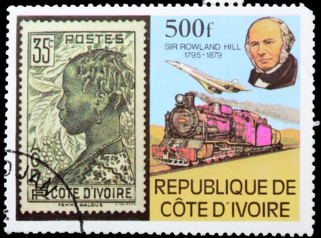 postmail: COTE DIVOIRE - CIRCA 1979: A stamp printed in Republic Cote dIvoire shows portrait of sir Rowland Hill and train, circa 1979