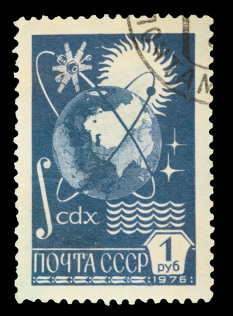 USSR - CIRCA 1976: a stamp printed by USSR shows Globe, Sun and Shutnik Orbits , circa 1976 photo