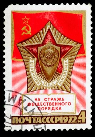 USSR- CIRCA 1972: a stamp printed by USSR, shows emblem, star, symbols soviet police , circa1972 photo
