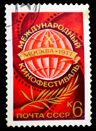 USSR - CIRCA 1977: The postage stamp printed in USSR shows an international film festival, circa 1977 photo