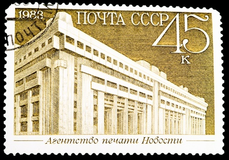 USSR - CIRCA 1983: A Stamp printed in USSR shows the Novosti Press Agency, from the series Newly Completed Buildings, Moscow, circa 1983 photo
