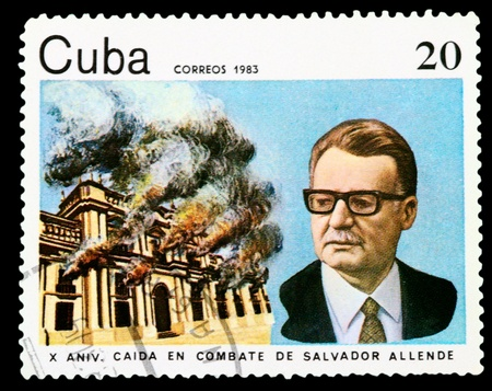 salvador allende: CUBA - CIRCA 1983: A stamp printed in Cuba shows Salvador Allende on the background of the burning palace Moncada, circa 1983