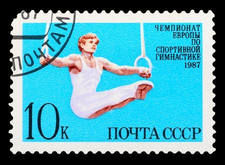 piscina olimpica: URSS - CIRCA 1987: El sello postal impreso en la URSS muestra el campeonato de Europa en una gimnasia deportiva, alrededor del año 1987