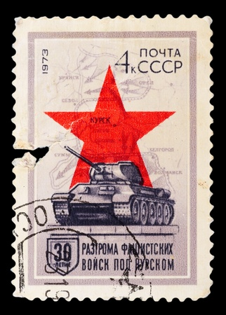 USSR - CIRCA 1973: A post stamp printed in USSR shows tank T-34, red star and map, devoted 30 years of Kursk Battle, circa 1973 photo