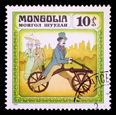 MONGOLIA - CIRCA 1982: A stamp printed in Mongolia shows old-time France bicycle 1863, series Historic bicycle, circa 1982 photo