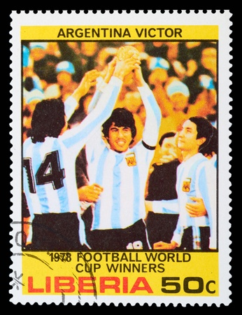 football referee: LIBERIA - CIRCA 1978: a stamp printed by LIBERIA, shows football players in world football cup in Argentina, circa 1978
