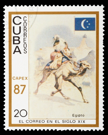 camel post: CUBA - CIRCA 1987: A post stamp printed in Cuba shows postman on camel, Egypt, end of XIX century. circa 1987 Stock Photo