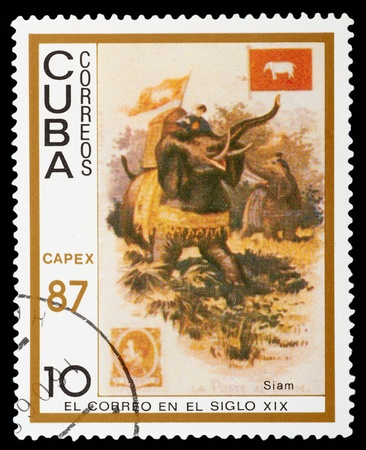 CUBA - CIRCA 1987: A post stamp printed in Cuba shows a man on elephant. circa 1987 Stock Photo - 12550291