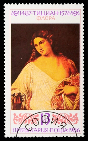 magyar: BULGARIA - CIRCA 1986: A stamp printed in Bulgaria shows the painting Flora by Titian, circa 1986