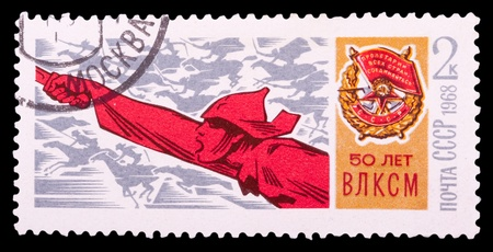 recompense: USSR - CIRCA 1968: A stamp printed in USSR, shows young workers and Order of Lenin, devoted to the 50-th anniversary of Komsomol, circa 1968