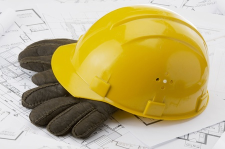 A yellow hard hat over a construction drawing Stock Photo