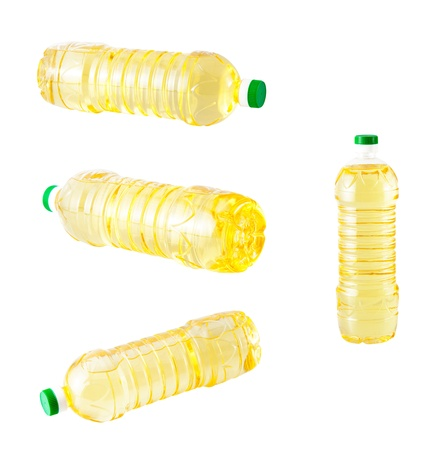 Set of a vegetable oil in a plastic bottle isolated on a white background photo