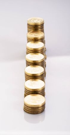 The stack of gold coins isolated on a white background photo