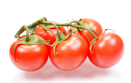 The fresh juicy tomatoes isolated on a white background photo