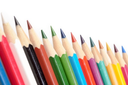 The colored pencils isolated on a white background photo