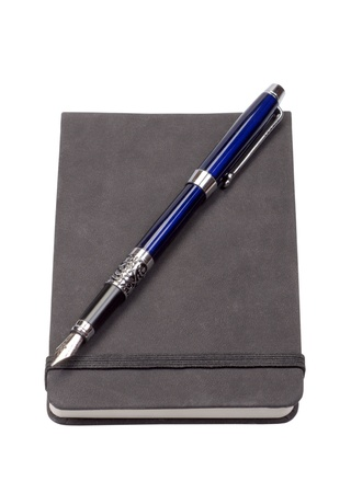 The diary with a blue fountain pen isolated on a white background photo