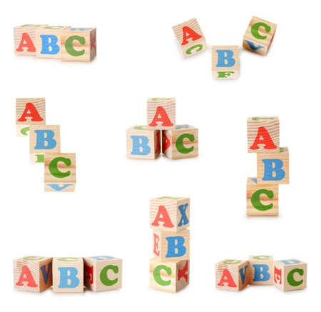 Set of a wooden alphabet blocks isolated on a white background photo