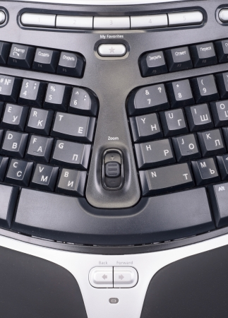 The computer keyboard on a background photo