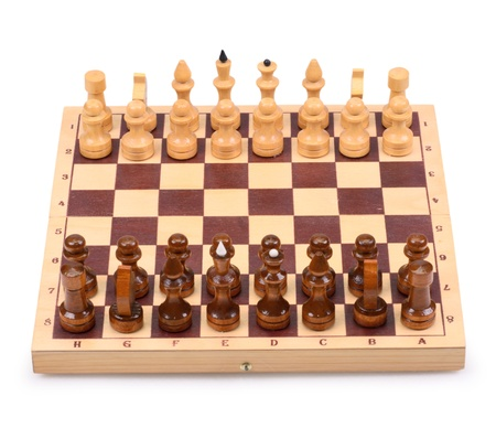 The wooden chess pieces on a chess board isolated on a white background photo