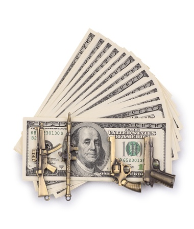 pack of dollars and weapon isolated on a white background photo