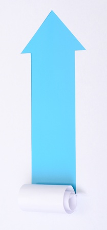 Ripped white paper in the shape of an arrow with space for text with blue background