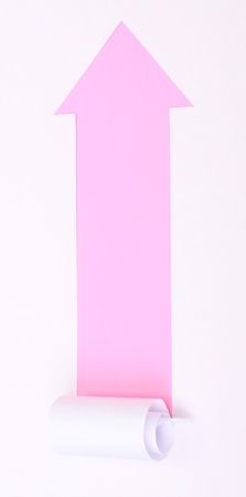 Ripped white paper in the shape of an arrow with space for text with pink background