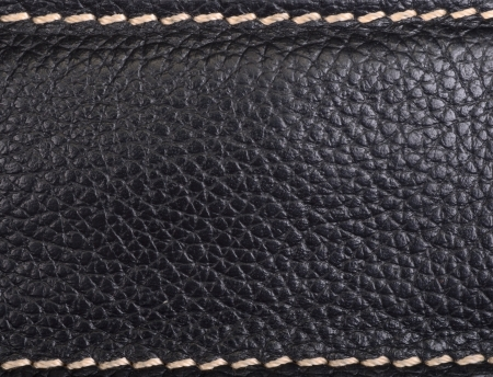Leather texture colose-up with linear stiches photo