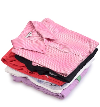 Stacks of many colored clothes isolated on a white background photo