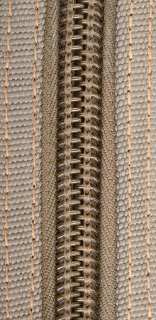 brown fabric texture and zipper background photo