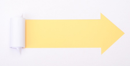 Ripped white paper in the shape of an arrow with space for text with yellow background photo