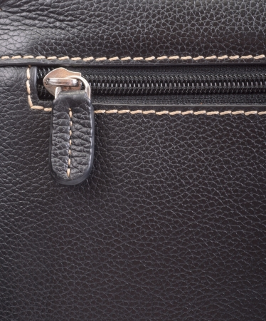 Dark brown leather texture and zipper background photo