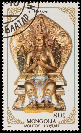 MONGOLIA - CIRCA 1988: A stamp printed in the MONGOLIA, shows statue of Buddhist deities, series, circa 1988 Stock Photo - 20492292