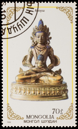 deities: MONGOLIA - CIRCA 1988: A stamp printed in the MONGOLIA, shows statue of Buddhist deities, series, circa 1988