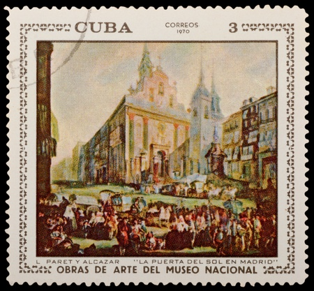 CUBA - CIRCA 1970: A stamp printed in the CUBA, shows Puerta del Sol in Madrid by Paret y Alcazar, circa 1970