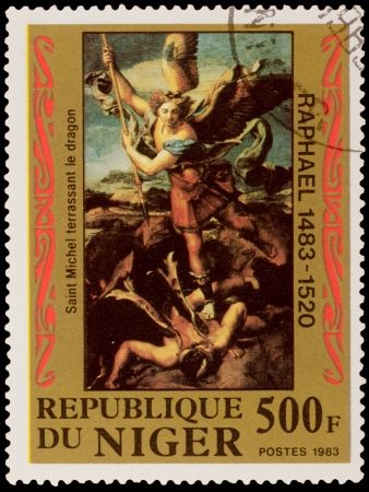 slaying: NIGER - CIRCA 1983: A stamp printed in the NIGER, shows Raphaels painting Saint Michael slaying the Dragon, circa 1983