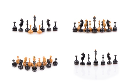 Set of a wooden chess pieces isolated on a white background photo