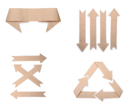 Set of a arrows from old paper isolated on a white background photo