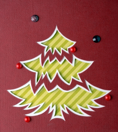 Christmas tree cut out from paper photo