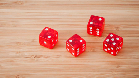 red dice: red dice on a wooden background
