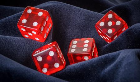 blue velvet: red dice on a blue velvet background