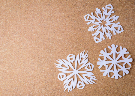 white textured paper: paper textured background with a white snowflakes
