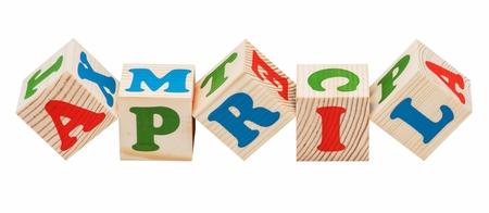 apri: wooden cubes. Apri word isolated on a white background Stock Photo