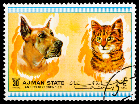 ajman: AJMAN STATE - CIRCA 1974: A stamp printed in Ajman State shows Dogs and cats, series Pets, circa 1974